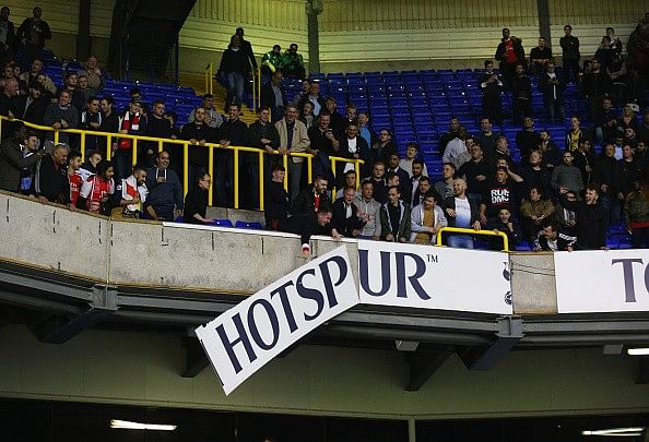 Video: Arsenal fans tear down hoardings during Capital One cup match against Tottenham