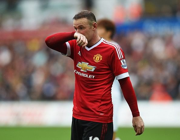 David Beckham suggests Wayne Rooney should adapt to be successful at Manchester United