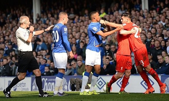 Liverpool and Everton play out a 1-1 draw in feisty Merseyside Derby