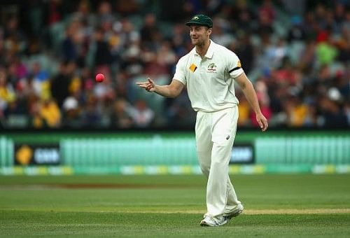 Australia field team masseur on Day 1 of historic Day/Night Test