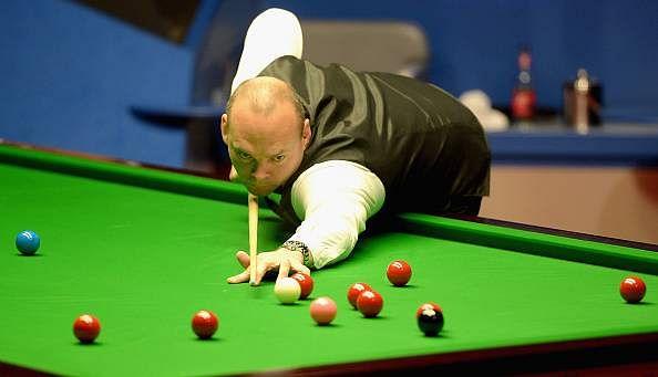 World Champion Stuart Bingham beats Ding Junhui in the Snooker Masters