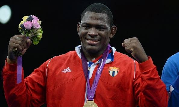 Cuban wrestler Mijain Lopez aims for a third Olympic gold in 2016