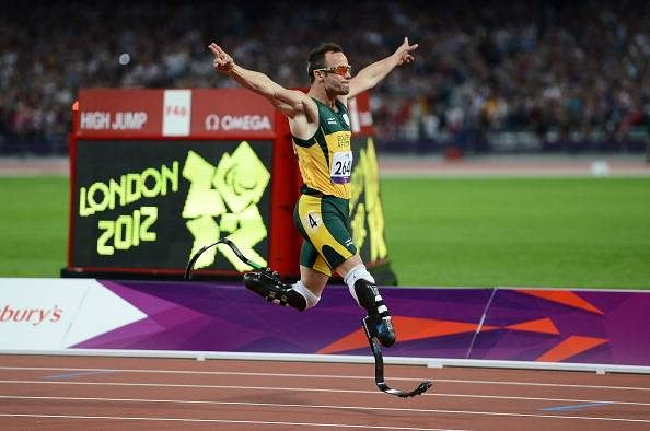 How did Oscar Pistorius lose his legs?