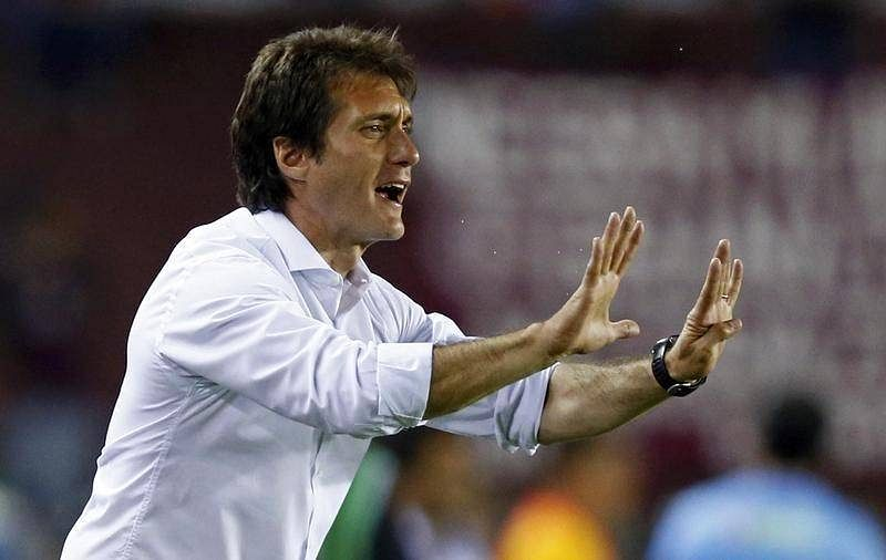 UEFA regulation forces Palermo coach Schelotto to leave