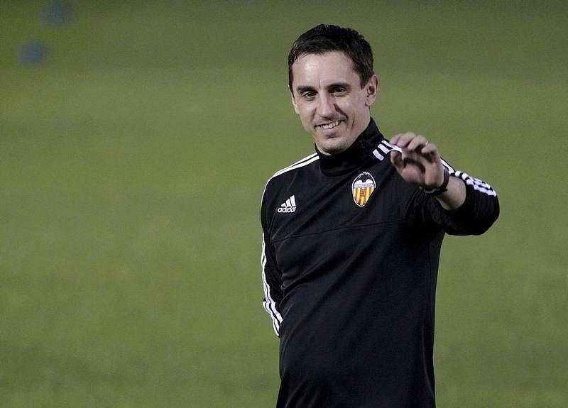 Valencia's Neville staying calm in 'eye of the storm'