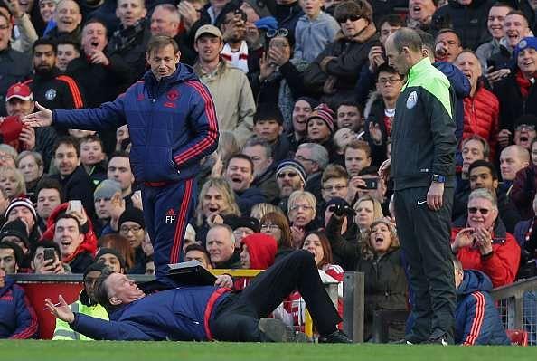 The internet photoshops Louis van Gaal's infamous dive against Arsenal