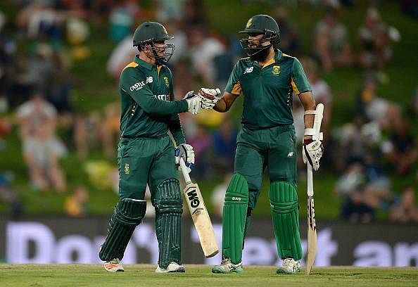 Centuries from Hashim Amla and Quinton de Kock help South Africa seal record chase