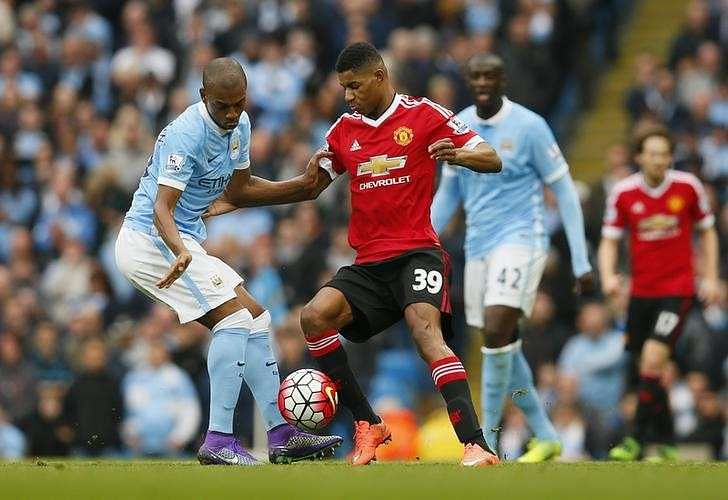 Football Soccer - Manchester City v Manchester United - Barclays Premier League - Etihad Stadium - 20/3/16 Manchester City's Fernandinho in action with Manchester United's Marcus Rashford Action Images via Reuters / Jason Cairnduff Livepic