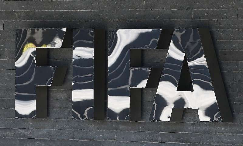 The FIFA logo is seen at the FIFA headquarters in Zurich, Switzerland ...