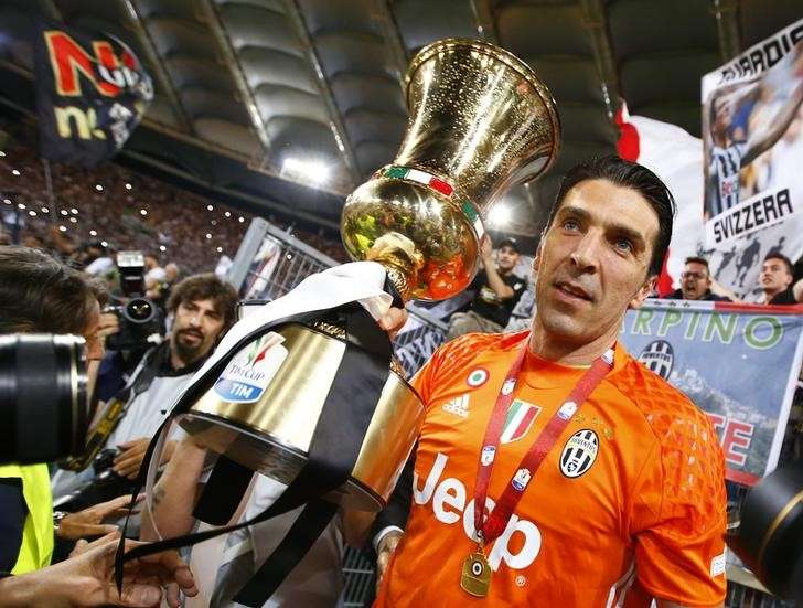 Goalkeeping giant Buffon stands test of time for Italy