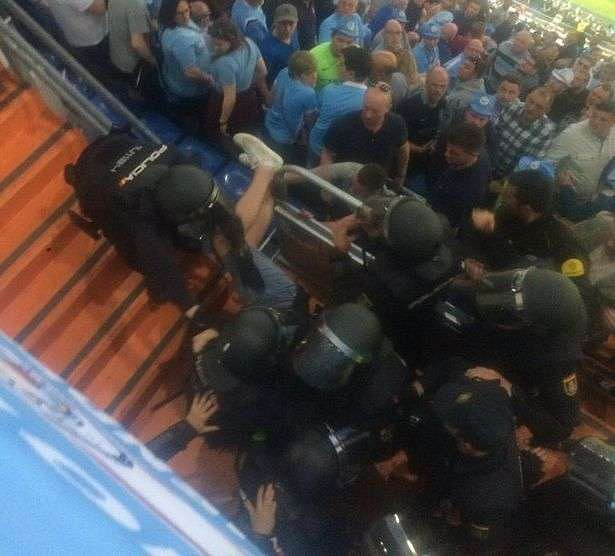 Watch: Manchester City fans punched by riot police during Champions League semi final vs Real Madrid.
