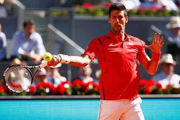 Madrid Open: Novak Djokovic and Kei Nishikori move into third round as women's seeds falter