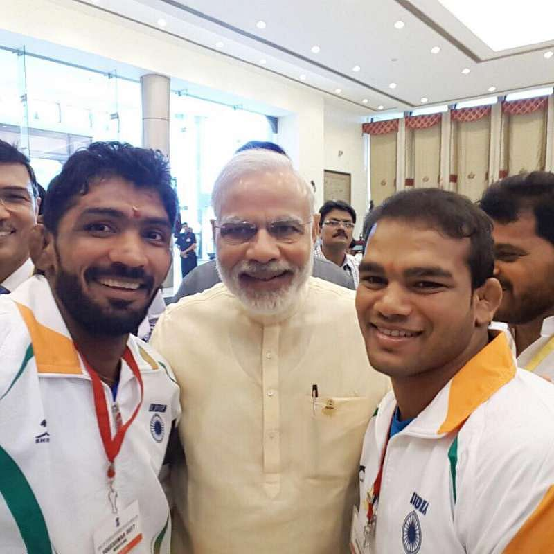Dutt and Narsingh with Modi. Image Courtesy: Sportskeeda