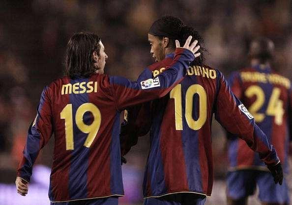 Messi of barcelona congratulates ronaldinho after he scored barcelona