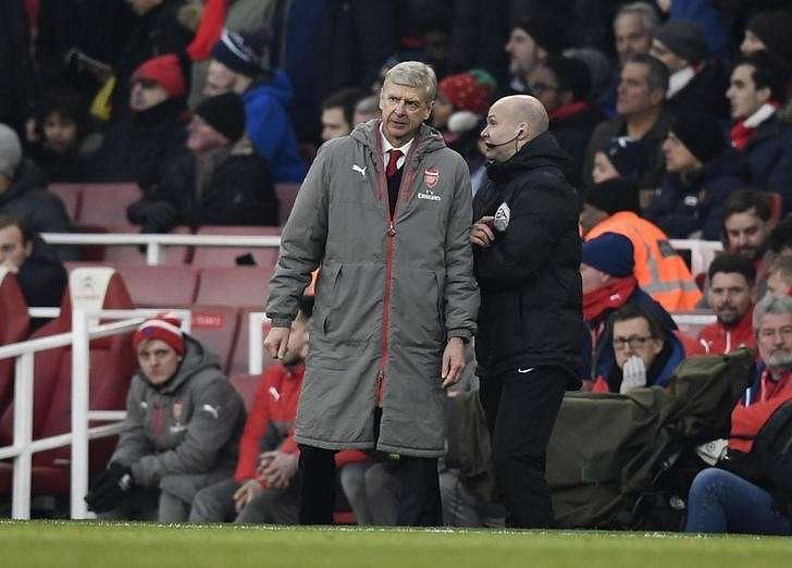Football Soccer Britain - Arsenal v Burnley - Premier League - Emirates Stadium - 22/1/17 Arsenal manager Arsene Wenger clashes with fourth official Anthony Taylor before being sent to the stands Reuters / Dylan Martinez/ Livepic/ Files
