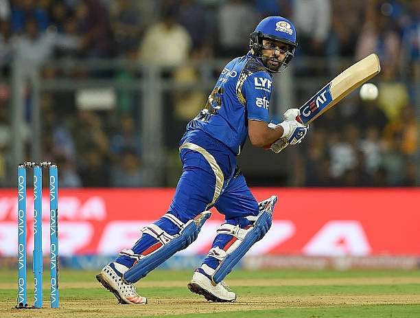 Mumbai Indians' captain Rohit Sharma plays a shot during the 2016 Indian Premier League (IPL) Twenty20 cricket match between Mumbai Indians and Kolkata Knight Riders at The Wankhede Cricket Stadium in Mumbai on April 28, 2016. / AFP / PUNIT PARANJPE / ----IMAGE RESTRICTED TO EDITORIAL USE - STRICTLY NO COMMERCIAL USE----- / GETTYOUT (Photo credit should read PUNIT PARANJPE/AFP/Getty Images)