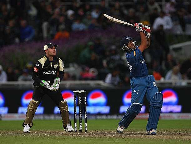 CAPE TOWN, SOUTH AFRICA - APRIL 19: Rohit Sharma of Deccan Chargers hits out at Brendon McCullum of Kolkata looks on during the IPL T20 match between Deccan Chargers and Kolkata Knight Riders on April 19, 2009 in Cape Town, South Africa. (Photo by Tom Shaw/Getty Images)