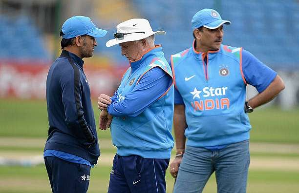 LEEDS, ENGLAND - SEPTEMBER 04:  India coach Duncan Fletcher looks at his watch alongside Ravi Shastri and Mahendra Singh Dhoni during a nets session at Headingley on September 4, 2014 in Leeds, England.  (Photo by Gareth Copley/Getty Images)