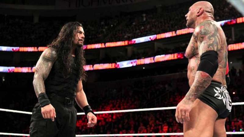 Roman Reigns and Batista in the ring
